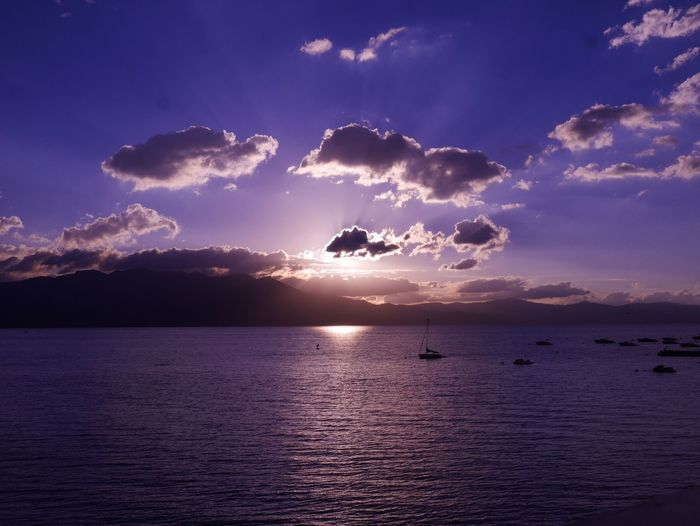 Scenic View Of Boats On Lake Tahoe At Sunset