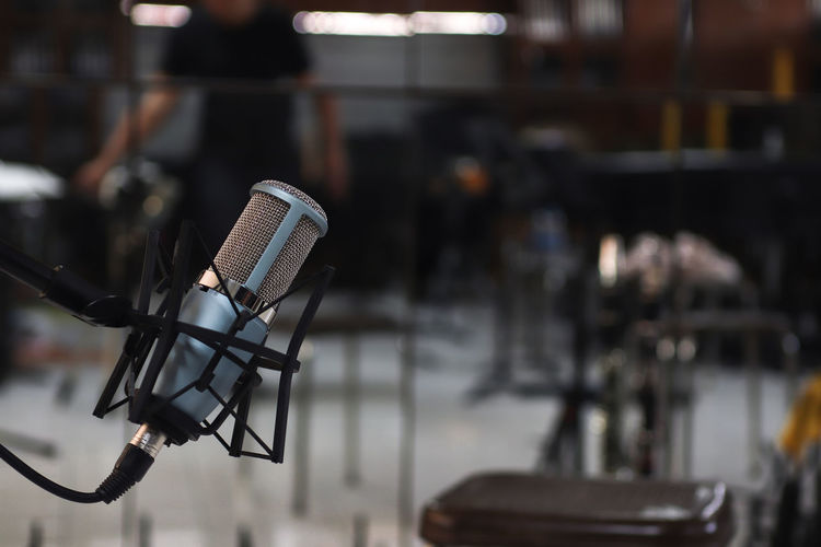 Microphone on Studio background Microphone Input Device Focus On Foreground Indoors  Technology Arts Culture And Entertainment Music Metal Absence Close-up Studio Selective Focus Seat Recording Studio Audio Equipment No People Microphone Stand Equipment Sound Recording Equipment Stage Electrical Equipment