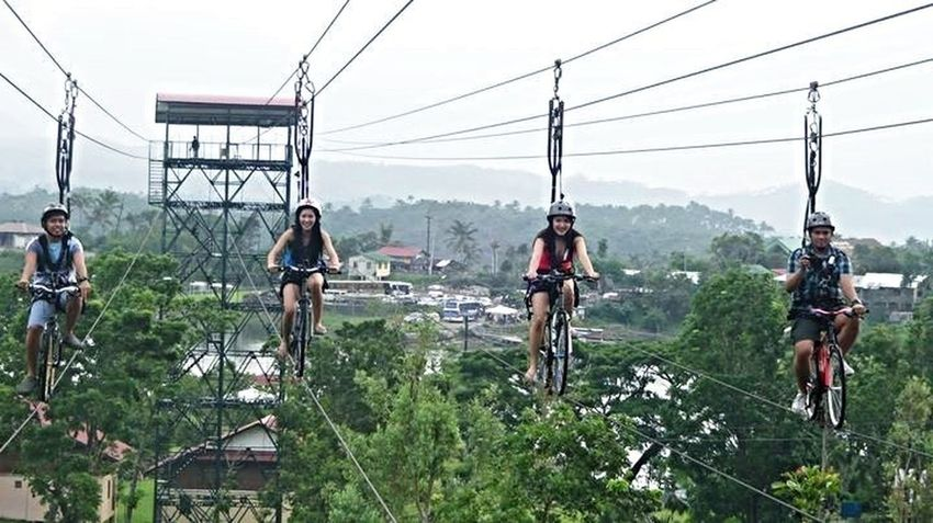 Cable Casual Clothing Cloud - Sky Day Growth Heights Landscape Leisure Activity Lifestyles Mountain Nature Outdoors Overhead Cable Car Partners Plant Power Line  Power Supply Sky Sky Bike Tree Windy