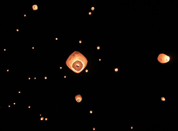 Celebration Of Lights Dark Flying Holiday Horizontal Illuminated Lantern Lighting Equipment Lights Festival Low Angle View Night No People Outdoors Paper Lantern Sky Traditional Festival EyeEmNewHere Go Higher
