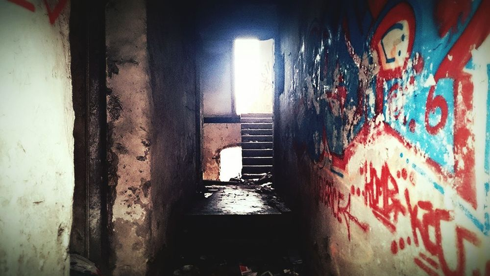 Shy light.. Destruction Abandoned Buildings Deserted Abandoned Places Window City December 2015 Cellphone Photography Light In The Darkness One Photo Every Day City Life Croatia Doors Walls Graffiti Wall