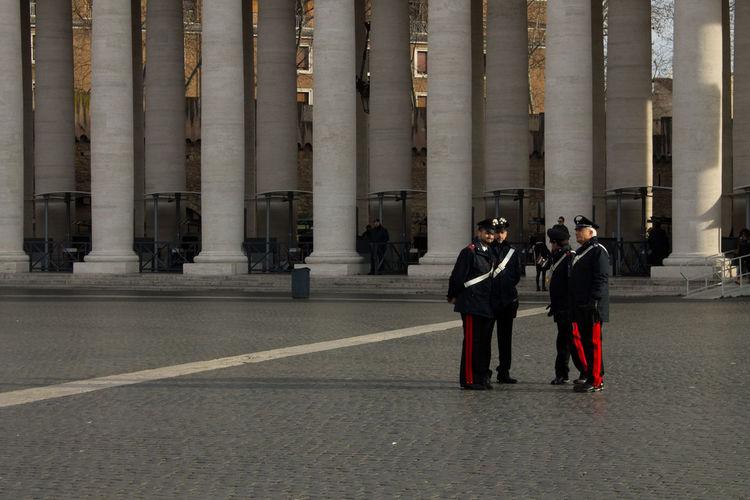 Men standing in front of people