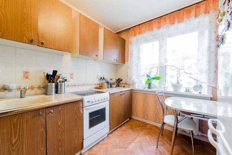 Interior room apartment. standard repair decoration in hostel. kitchen, dining area