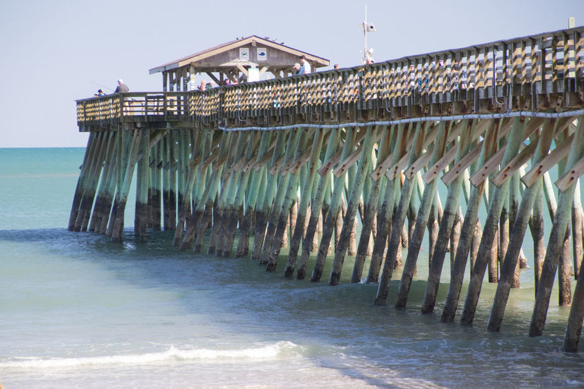 Pier at Myrtle Beach State Park Aquatic Sport Architectural Column Architecture Beach Building Exterior Built Structure Clear Sky Day In A Row Land Motion Nature No People Outdoors Pier Sea Sky Sport Water Waterfront Wooden Post