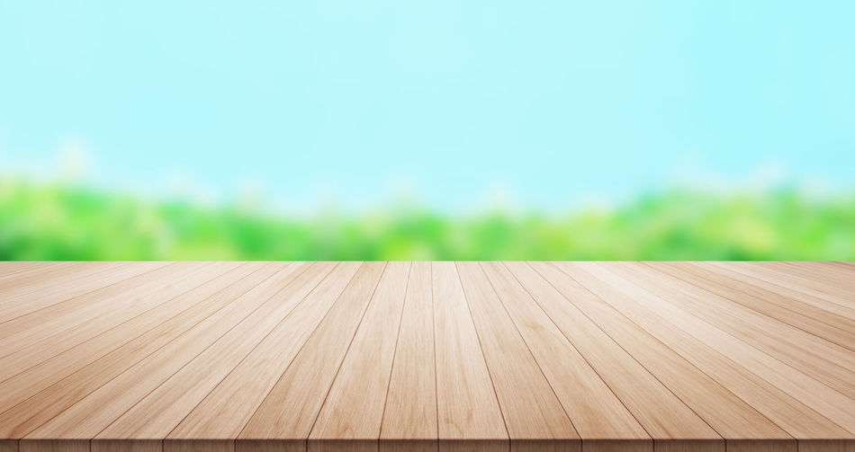 Empty wood table top on green leaf and blue sky background for display or montage product Backgrounds Close-up Day Focus On Foreground Nature No People Outdoors Summer Table, Wood, Empty, Isolated, Nature, Leaf, Sun Shine, Sunny, Blue Sky, Green Background, Top, Desk, Mockup, Mock Up, Light, Display, Counter, Product, Deck, Space, Montage, Plank, Tabletop, Desktop, Design, Board, Surface, Blank, Isolate, Wooden, Outdoor Wood - Material