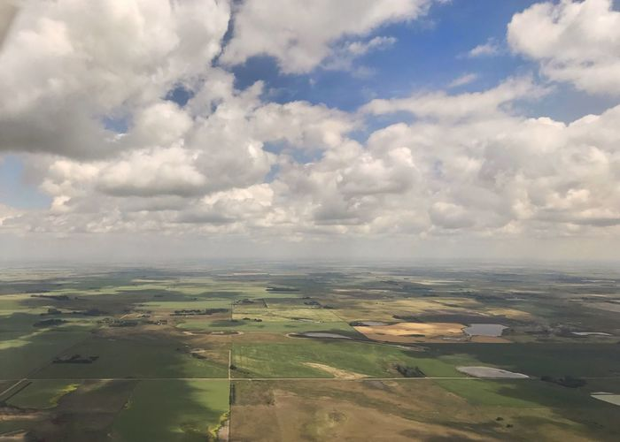 Patchwork landscape under clouds. Agriculture Patchwork Landscape Quilt Scenics Rural Scene Landscape Field Cloud - Sky Horizon Horizontal View From Airplane
