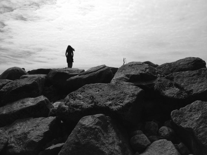 Silhouette Woman Standing On Rocks