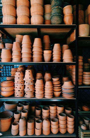 Various Pots On Shelves For Sale In Store