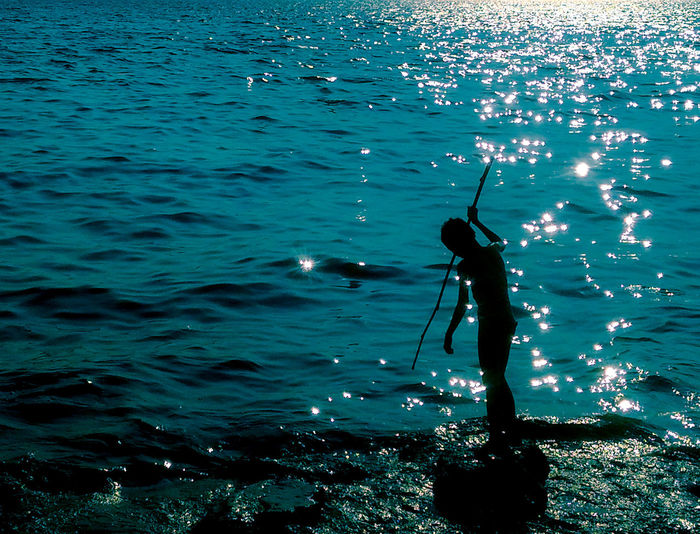 Boy Fishing In Sea