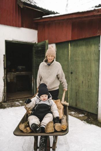 Full length portrait of siblings in winter