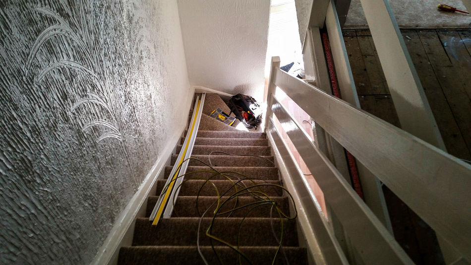 Electrical Cable Wire Trunking Earth Carpet Stairs Steps Work Building Interior No People Floorboards Real Jobs Dark Indoors  Bannister Handrail  Wood House Home Top Of Stair Artex Textures And Surfaces Textured Wall