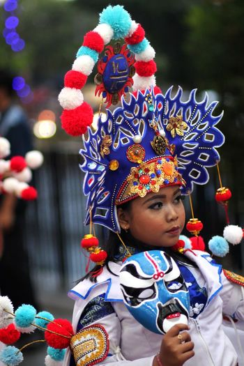 Close-Up Of Young Woman Wearing Headdress