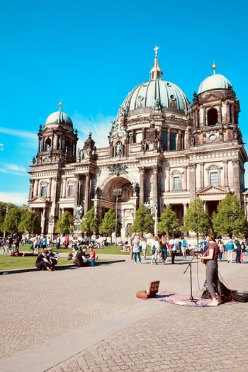 People at berlin cathedral against sky