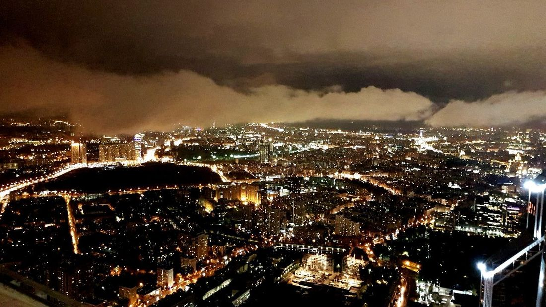 Mobility in Mega Cities Illuminated Cityscape Night No People Sky Outdoors Aerial View City Power In Nature Beauty In Nature Nature Lightning