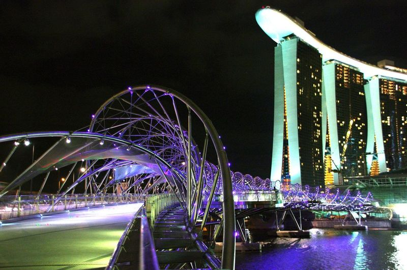 Low angle view of illuminated marina bay sands against sky at night