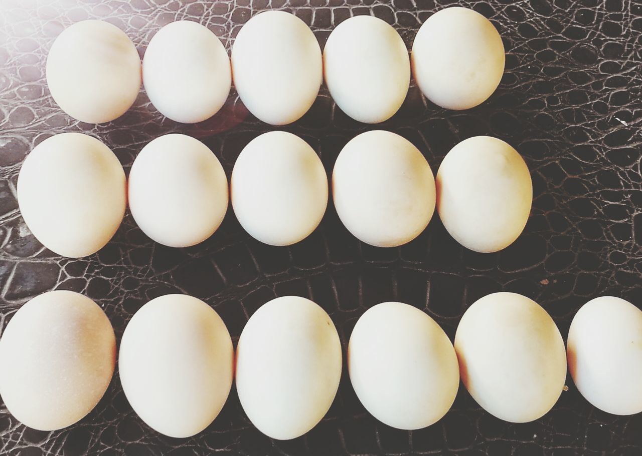 egg, in a row, order, arrangement, egg carton, high angle view, food and drink, no people, food, large group of objects, indoors, healthy eating, fragility, freshness, close-up, day