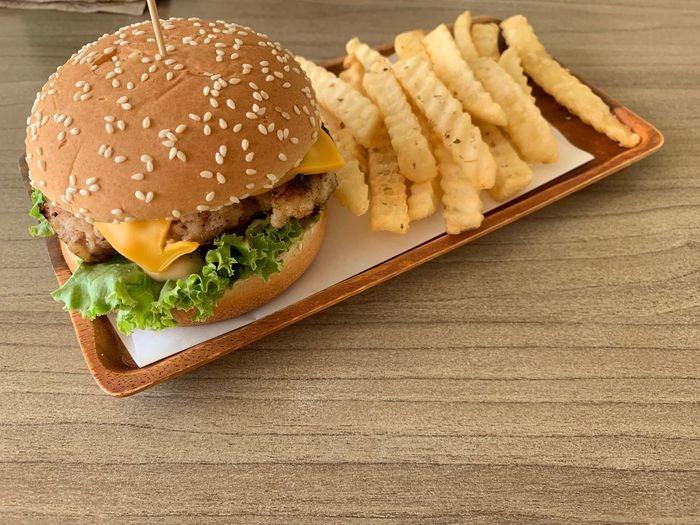 Fast Food Unhealthy Eating Sandwich Ready-to-eat Burger Food Food And Drink French Fries Hamburger Potato Prepared Potato Still Life Bread Freshness Indoors  Close-up Indulgence Table No People Fried Snack Bun Take Out Food Temptation Relish