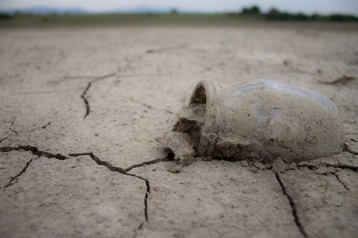 Abandoned Dirty Cracks In The Earth Jar No People Dry Land Dry Lake Close-up Focus On Foreground Outdoors Nature