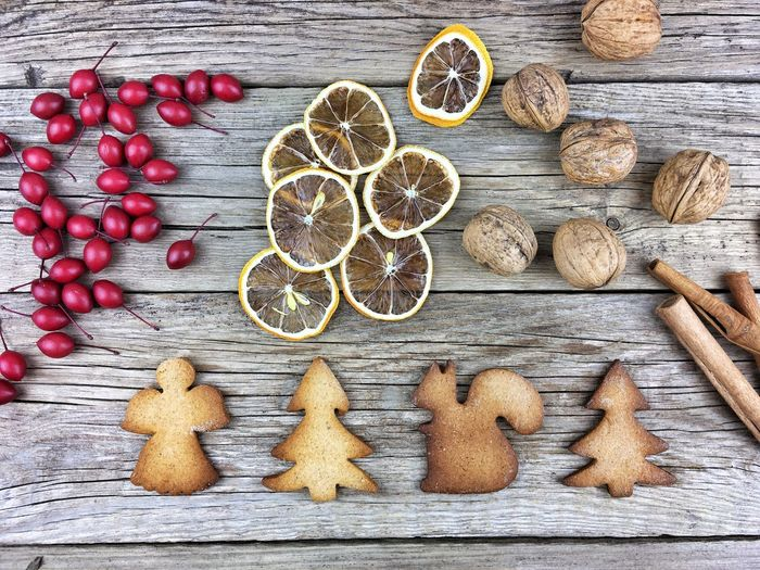 Christmas Cookies Cinnamon Citrus Fruit Decoration Directly Above Food Food And Drink Freshness Fruit Gingerbread Healthy Eating High Angle View Indoors  Large Group Of Objects No People Orange Spice Spices Still Life Studio Shot Table Variation Walnut Wellbeing Wood - Material