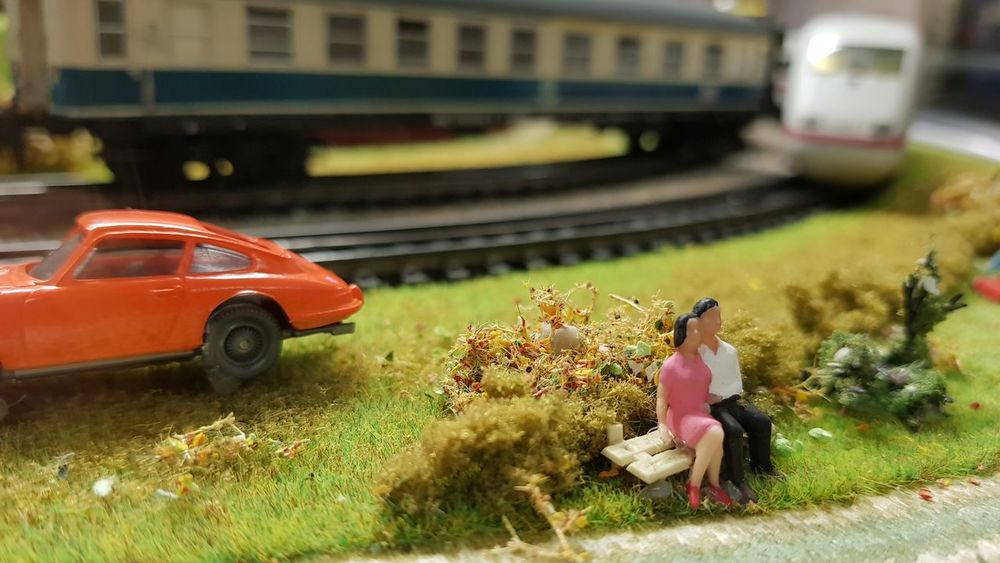 Model Railway Model Railway Layout Figure Couple Made From Plastic Plastic Small Figure Small Figures Green Color Plastic Grass Hobby Things Around Me Scenics Personal Perspective Details Of My Life Card Design Art Photography Day Structure No People Art Is Everywhere Surface Focus On Foreground Close-up