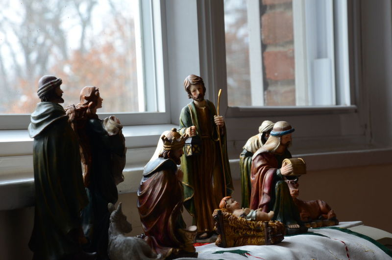 Close-Up Of Nativity Scene On Window At Home