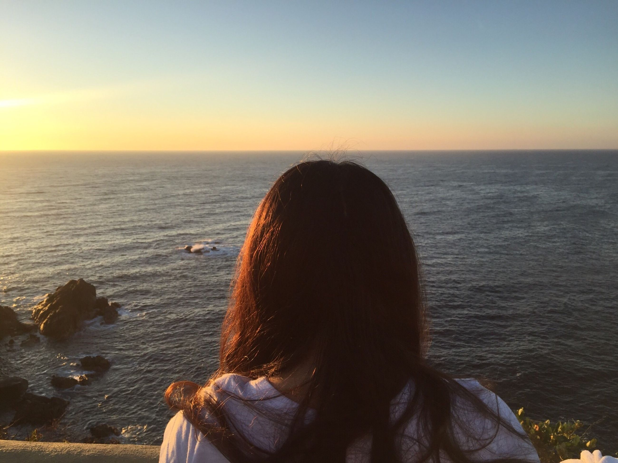 sea, horizon over water, rear view, headshot, sunset, water, real people, nature, scenics, lifestyles, beauty in nature, idyllic, one person, clear sky, outdoors, sky, tranquility, women, beach, close-up, day, people, adult