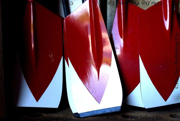 Oar blades sport Harvard colors.