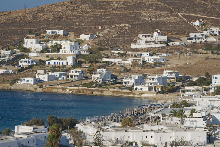 Ornos village - Mykonos island - Aegean sea - Greece Aegean Mediterranean  Architecture Bay Beach Building Building Exterior Built Structure City Community Day Greece High Angle View Island Mountain Mykonos Nature No People Ornos Outdoors Residential District Sea Town TOWNSCAPE Water