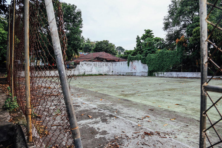 Abandoned Abandoned Places Architecture ASIA Building Exterior Built Structure Court Courtyard  Damaged Fence INDONESIA Metal No People Obsolete Outdoors Run-down Sky Sport Sports Weathered