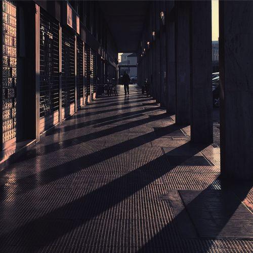 Corridor in building on sunny day