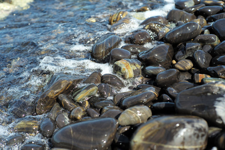 High angle view crowd of polished stones on shore