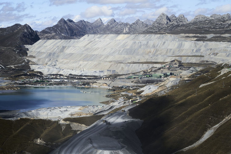 Mine in the high country of the andes, terraces of excavation and commercial mining equipment