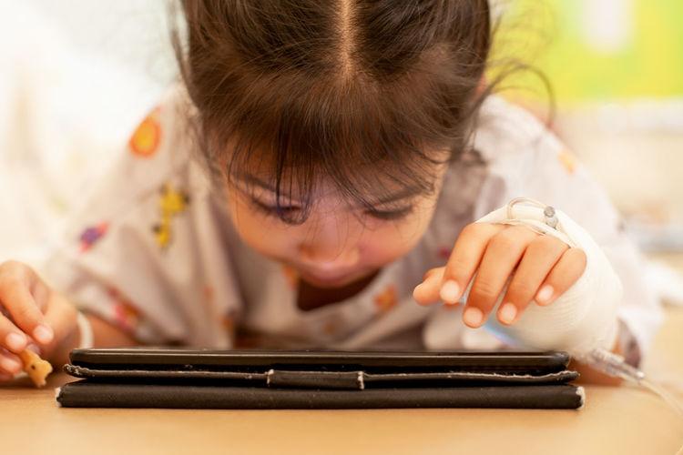 Girl using digital tablet at home