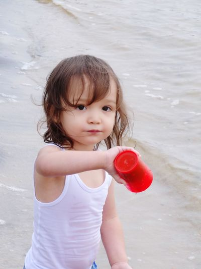 EyeEm Selects Childhood Child One Person Real People Cute Girls Innocence Females Leisure Activity Water Women Lifestyles Casual Clothing Day Holding Playing Land Standing Outdoors