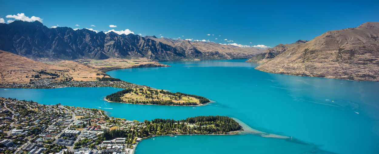Queenstown, New Zealand with Lake Wakatipu after a rock avalanche in the Dart Valley Beauty In Nature Clear Sky Coastline Day Hiking Lake Landscape Mountain Mountain Range Nature New Zealand Outdoors Queenstown Relaxation Remarkables Scenics Sky South Island Summer Travel Travel Destinations Water