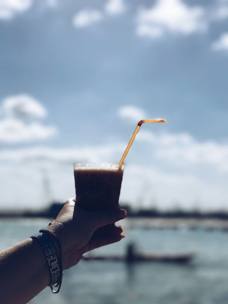 ShotOnIphone Beauty In Nature Close-up Cloud - Sky Cocktail Day Drink Drinking Glass Drinking Straw Focus On Foreground Food And Drink Freshness Holding Human Body Part Human Hand IPhone7Plus Lake Nature One Person Outdoors People Real People Refreshment Shotoniphone7plus Sky Water מייאייפון7 מייבתגלים מייחיפה מייים מייפוד