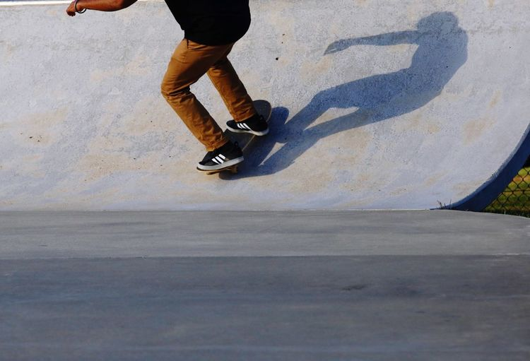 Shadow of a moving skateboarder. Wheels Concrete Skateboard JGLowe Fun Concrete Low Section Human Leg Body Part Human Body Part Lifestyles One Person Men Human Limb Real People Limb Leisure Activity Motion Day Shadow Sunlight Sport Outdoors