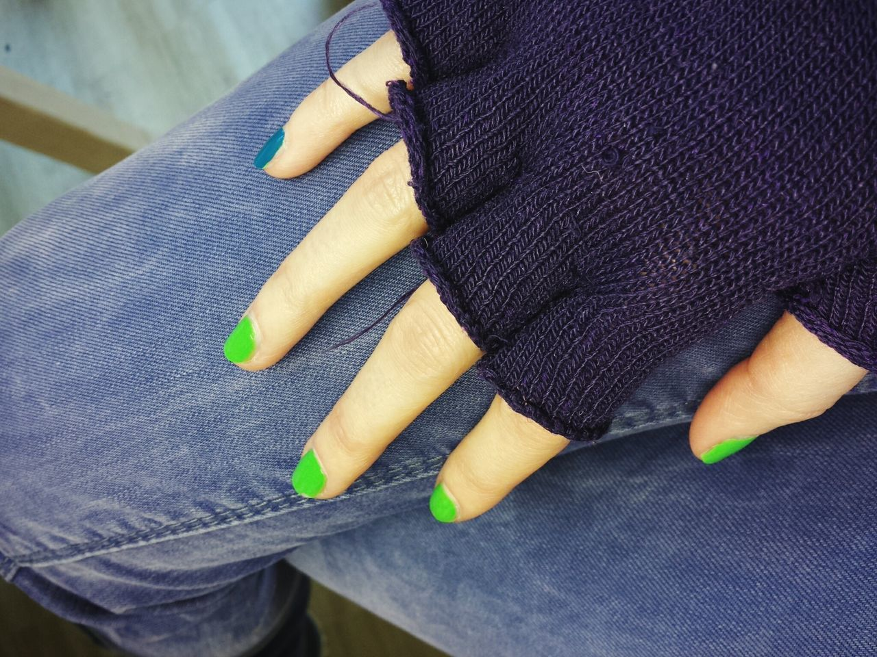 Midsection Of Woman Hand With Green Nail Polish