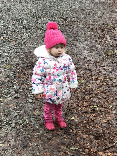 Little girl out for a walk in the mud Babies Only Babyhood Childhood Cute Day Full Length High Angle View Innocence One Person Outdoors People Pink Color Real People Standing