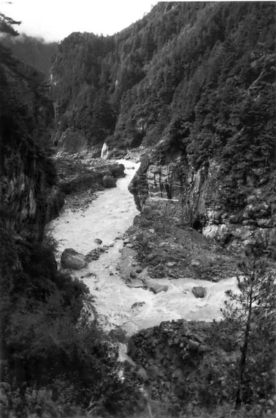 The Dudh Kosi river, about halfway between Lukla and Namche Bazaar,, Everest Region, Nepal. The river is an extreme white water river, too fast and dangerous for water sports of any kind. Dudh Kosi Everest Region Namche Bazaar Riverside Sagarmatha National Park Beauty In Nature Cliff Day Landscape Lukla Mountain Nature Nepal Travel No People Outdoors River Rock - Object Scenics Sky Water