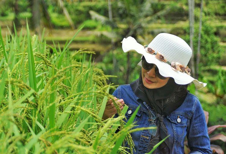 Woman wearing hat on padi field