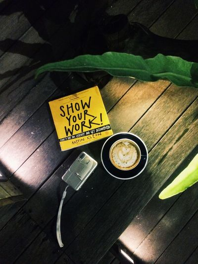 Camera and Coffee Reading INDONESIA Bandung Book Austinkleon Showyourwork Analogue Photography Camera Coffee Text Western Script High Angle View Communication Sunlight Wood - Material Day Food And Drink Plant First Eyeem Photo