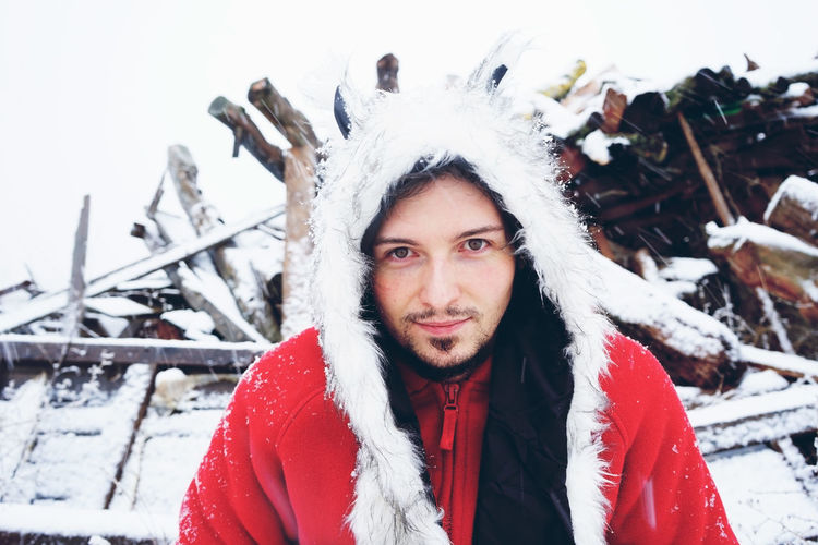 Winter Cold Temperature Snow Portrait Looking At Camera Warm Clothing Clothing One Person Front View Real People Leisure Activity Standing Young Adult Headshot Day Lifestyles White Color Young Men Scarf Outdoors Extreme Weather Fur Hat