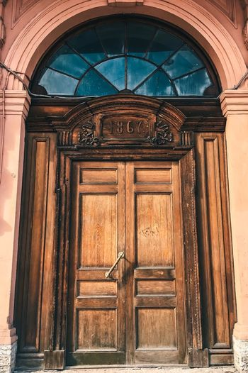 Low angle view of closed door of old building