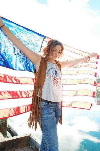 One Person Sunlight Low Angle View Outdoors Patriotism Holding Flag Summer Portrait Cheerful One Woman Only One Young Woman Only People Portraits America American Flag USA Leather Jeans Millennials Millenials Sky Day Dock Lake Love Yourself Press For Progress