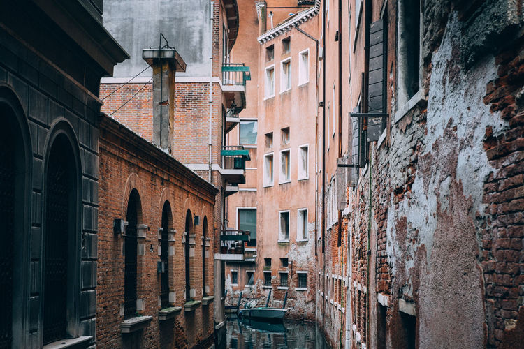 Canal amidst old buildings