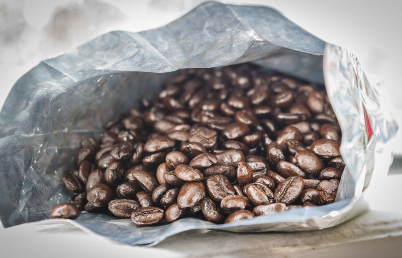 Coffee bean in the bag of aluminum foil. Abundance Bag Brown Caffeine Close-up Coffee Coffee - Drink Container Focus On Foreground Food Food And Drink Freshness Indoors  Large Group Of Objects No People Paper Plastic Plastic Bag Roasted Roasted Coffee Bean Still Life Table Temptation The Still Life Photographer - 2018 EyeEm Awards