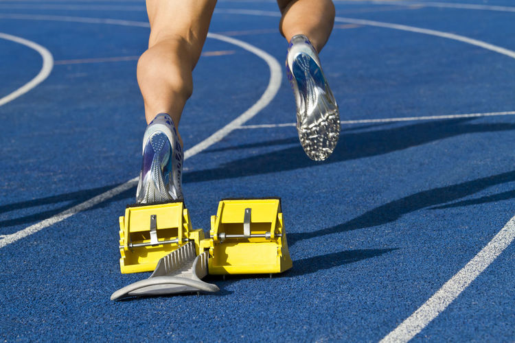 Low section of person on sports track