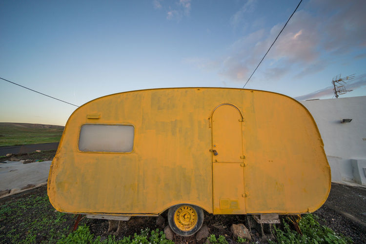 Yellow Motor Home Against Sky