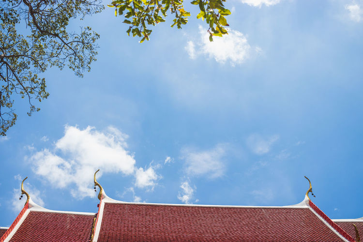 Sky Architecture Cloud - Sky No People Nature Day Outdoors Roof Low Angle View Built Structure Building Exterior Building High Section Plant Blue Tree House Roof Tile Sunlight Place Of Worship Directly Below